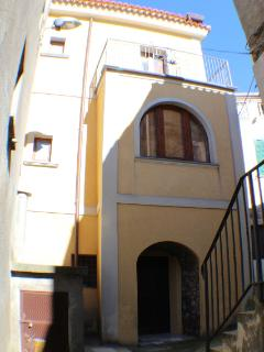 The door to the large laundry and the small terrace belonging to the double bedroom