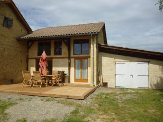 House front with BBQ and decking area - perfect for alfresco dining!