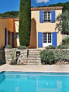 Villa, pool and terrace with steps up to French windows to master bedroom