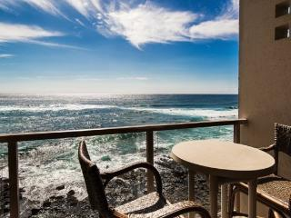 Free Car* with Kuhio Shores 416-4th floor condo, ocean and sunset views. Watch the surfers from this ocean front 1 bedroom/1 bath condo., Poipu