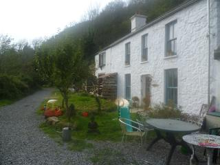 View of whole house- holiday let attached to owners house. Path follows Gower coastal path