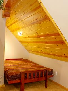 Right side bed in the loft
