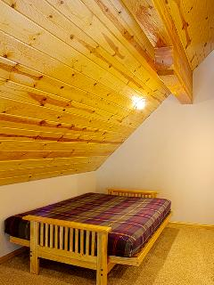 Left side bed in the loft