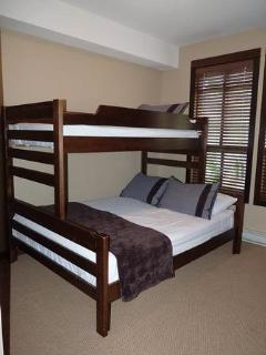 Bedroom 2 - bunkbed with a queen mattress on the lower bed and a twin mattress above. Flat screen TV