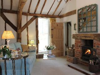 The double height sitting room with its woodburning stove