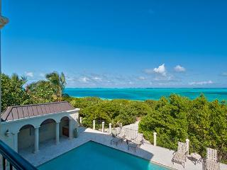 Located on the western end of Grace Bay Beach, this villa is nestled amid cloistered decks. TNC TAM, Providenciales
