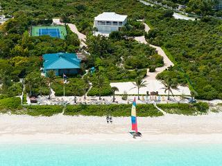 Located along Grace Bay Beach in Turtle Cove, this lovely tropical villa offers all modern amenities. TNC CON, Providenciales