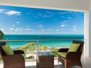 A short walk to the Turtle Cove Marina & Yacht Club, this cottage on Grace Bay only feels worlds away from the action. TNC OED, Providenciales