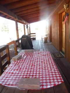 Back deck of cabin with BBQ
