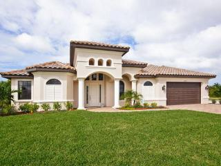 Beautiful 4 bedroom 4 bathroom Cape Coral villa with private pool, hot tub and waterway views.