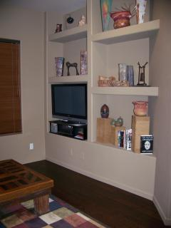 family room with 40' flat screen t.v. and desk