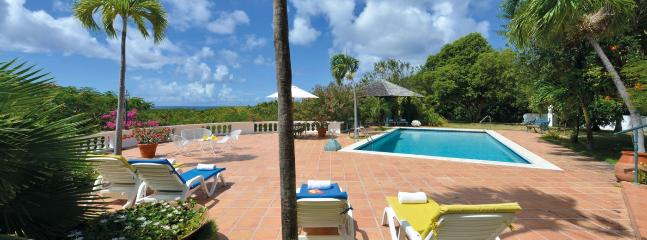 SPECIAL OFFER: St. Martin Villa 140 An Elegant Colonial West Indian Style Home Built In A U-shape Around A Flowered Interior Courtyard And Overlooks The Caribbean Sea., Terres Basses
