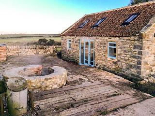 THE COWSHED, detached stone cottage with woodburning stove. Mostly ground floor. Patio with furniture, fire put and sea views, near Whitby, Ref 916824, Hawsker