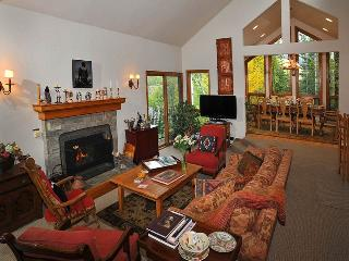 Surrounded by trees, and Spring flowers, this charming Vail vacation home sits on the slopes of Vail Mountain and provides exceptional vacation living at its best.