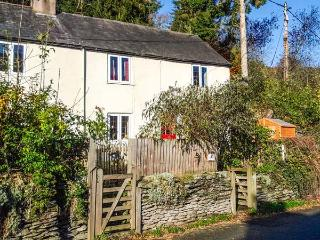 TAN Y RHOS ISA, semi-detached cottage with open fire, WiFi, pet-friendly, rear decking with furniture and valley views, in Glyn Ceiriog, Ref 30187