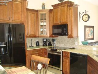 Kitchen Granite counters and Breakfast Bar