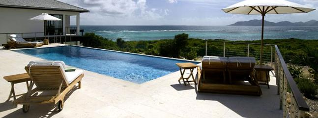 Villa Triton AVAILABLE CHRISTMAS & NEW YEARS: Anguilla Villa 113 Sitting On The South Shore, Anguilla Villa 113 Commands Stunning Views Of The Secluded Cove Beach And The Mountains Of St. Martin.