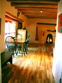 Upscale hardwood floor, light and bright dining window plus firelight ambiance