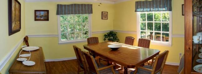 Bright and airy dining room with 8 chairs.