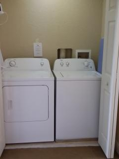 Our new washing machine and dryer also our iron and ironing board located at the top of the stairs