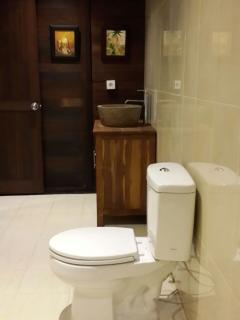 Spacious family bathroom with hot and cold water