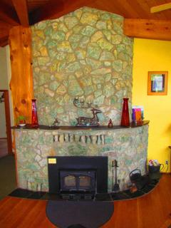 The fireplace and cedar tree are the centerpieces of the home