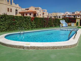 Apartment in Torrevieja with lovely terrace and shared pool, 3 bedrooms for 6 persons