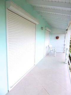 secure slotted metal shutters keep heat out and let breeze in