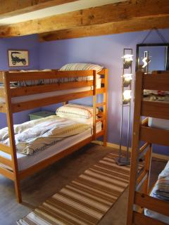 Bedroom five, the bunk room, sleeps four (beds are suitable for adults)