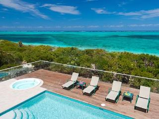 Nestled amid lush, tropical landscaping, this villa fronts miles of white sandy beach. TNC DAW, Providenciales