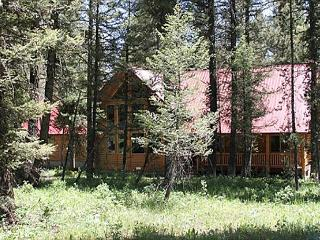 Pine Cone Lodge is settled back in the large fir trees., Island Park
