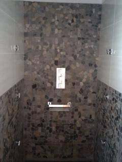 new walk in wet room with large rain fall shower & 6 side jets, large enough for the whole family !