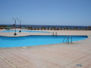 FRONTLINE SEA WITH HEATED POOL, PRIVATE TERRACE 12, Golf del Sur