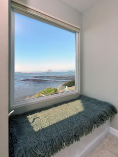 This window seat in the master bedroom provides you a wonderful spot to sit and gaze at the view.