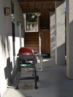 Downstairs Patio with grill, table and chairs.  Outside Shower in background.