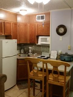 mini kitchen with pots and pans needed to cook.