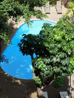 Even though you're a few steps from the beach there is a pool available for guests as well.