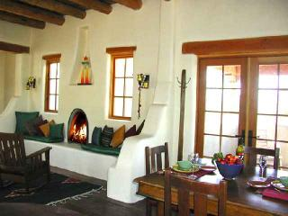 Authentic custom crafted woodburning Kiva fireplace and viga ceilings throughout