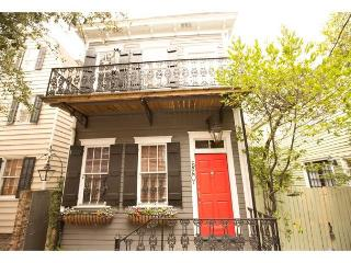Cute two story home with a balcony overlooking beautiful Greene Square, Savannah