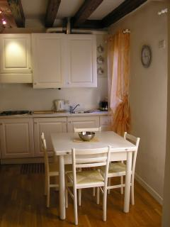 The fully equipped kitchenette and dining area.