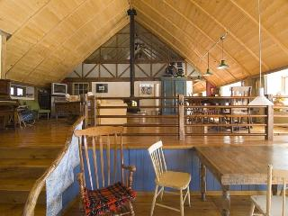 Century-old barn converted in strawbale house, Bromont