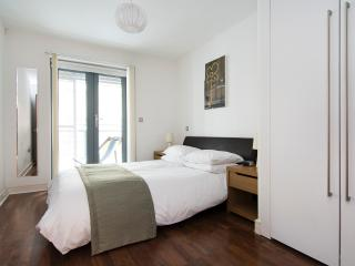 Master bedroom with ensuite bathroom, fitted wardrobes and direct access to private balcony