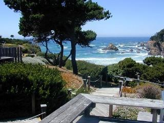 The expansive view from Windrift Cottage is framed on the left and right by t, Fort Bragg
