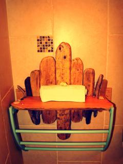 Hand-made driftwood bathroom shelf made from local beach-combed wood.