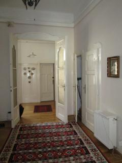 large hallway with Hungarian/Turkish rugs connecting lounge through to the kitchen