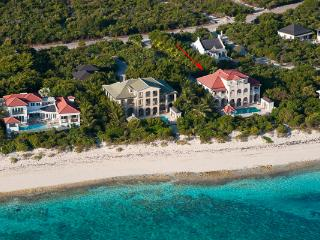 This waterfront manor- house, in Turtle Cove, has a large private swimming pool and is merely steps away from Grace Bay Beach. TNC PAP, Providenciales