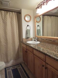 Full bath on second level adjacent to bedrooms.