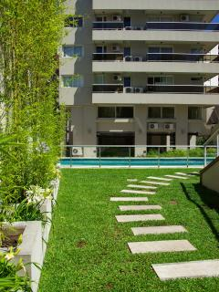 Landscaped gardens and swimming pool