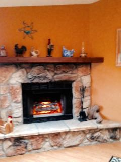 Large stone fireplace with ecological electric lighting