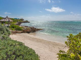 With its own secluded beach cove and views towards St. Martin, this villa is dramatically nestled in the rolling landscape. RIC KAM3, Little Harbour